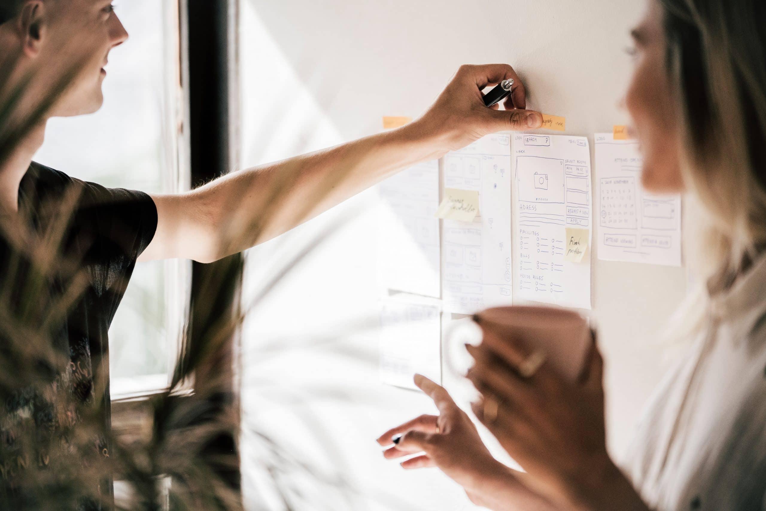 Two women undertaking startup ux design activities